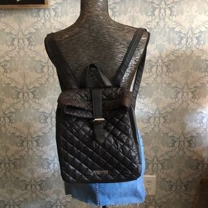 Black leather quilted backpack purse